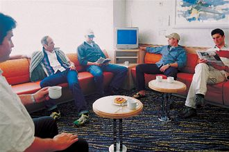Image depicting Men relaxing on board in the Driver's Lounge