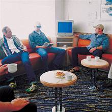 Men relaxing on board in the Driver's Lounge